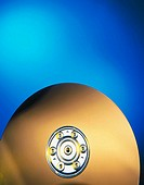 Gold hard drive on blue