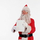 Father Christmas holding white A4 card