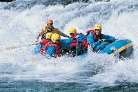 Five People White Water Rafting on Rapids