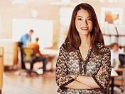Portrait of a Businesswoman Standing in An Open Plan Office