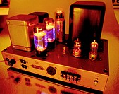 Vintage Heathkit vacuum tube amplifier with glowing tubes
