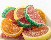Watermelon candy in white paper bag