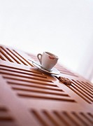 Cookie and tea cup sitting on wooden table