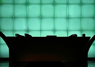 Desk in front of windows, silhouette