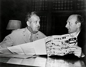 Major General Leslie R. Groves and David Lilienthal, the chairman of the Atomic Energy Commission. Groves was head of the Manhattan Project, the Ameri...