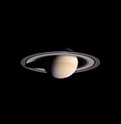 Saturn. The Cassini space probe beamed back this image on 8 March 2004 as it approached Saturn. The planet and its rings are lit up by the distant Sun...