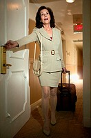 Businesswoman in hotel corridor