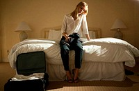 Lonely woman in hotel room
