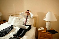 Relieved businessman in hotel room
