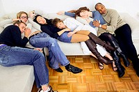 Friends sleeping on sofa