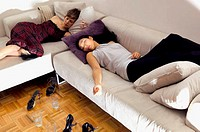 Women sleeping on sofa