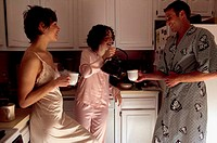 People drinking tea in kitchen