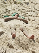 Man buried in sand