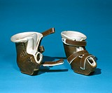 Orthopaedic boots designed for a child. From the DHSS Limb Fitting Centre at Roehampton, London.