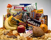 A selection of snacks, ranging from fruit to biscuits, chocolate bars and crisps. The consumption of snacks has become a serious nutrition and health ...