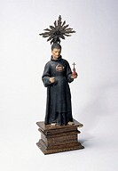 St John is patron saint of the sick. This Spanish pottery figure has a relic at its front which is said to be a splinter of Saint John's walking stick...