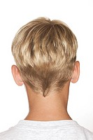 Portrait view of the back of a young blond haired boyøs head.