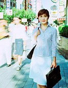 Asian Businesswoman Commuting to Work