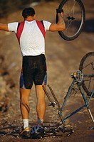 Man with Broken Mountain Bike