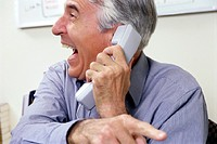Happy Businessman On Phone