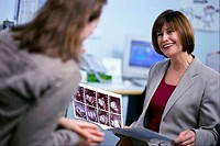 Gynecologist Discussing Fetal Scans with Patient