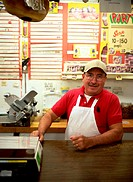Man Behind A Deli Counter