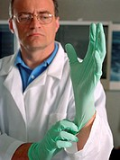 Doctor Putting On Rubber Gloves