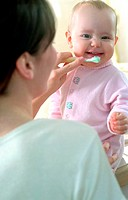 Mother Brushing Her Baby´s Teeth