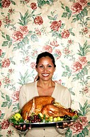 woman with Christmas turkey