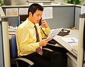 Asian Office Worker on Telephone