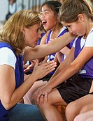 Soccer Coach Consoling Youth