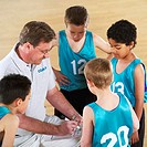 Basketball Coach in Team Huddle
