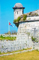 Turret and Cuban flag at San Carlos de la Cabaña fortress in the Parque Historico Militar Morro Cabaña. Havana, Cuba