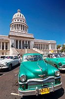 Classic American cars from the 1950s parked in front of the Capitolio Nacional. Havana, Cuba