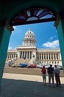 Tourists admire the impressive grandeur of the Capitolio Nacional. Havana, Cuba