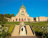 Family of worshippers climbing up the many steps of St-Joseph's Oratory (Oratoire St-Joseph) on their knees. Montreal. Quebec, Canada