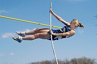 Female high school pole vaulter