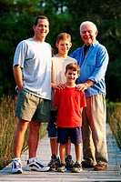 Portrait of multi-generational male family members smiling outdoors