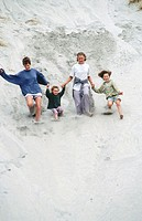 Family down sand dune. Wkarariki. North West Nelson. New Zealand.