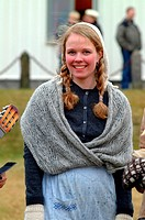 A teenage girl dressed up as rural people did in the old-time