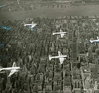Aierial view of silver bombers flying in formation over New York City