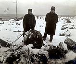 Men posng in snow next to mine