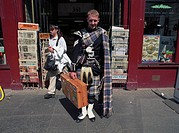 Man standing outside of store in his traditional Scottish kilt, Edingburg