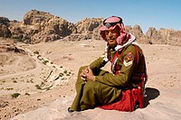 A soldier from the desert trops at The Urn Tomb in Petra. Jordan