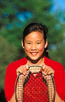 Asian girl with tennis racket