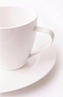 High key white tea cup and saucer on clean white background