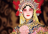 Traditional Peking Opera performer/singer on stage at the Li Yuan Theatre. Pekin, China