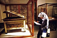 Student sketching ancient relic at Egyptian Museum. Cairo, Egypt