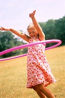 Little girl playing with hula-hoop (thumbnail)