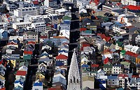 An aerial view of Reykjavik, the tower of Halllgrímskrikja in fornt of the town